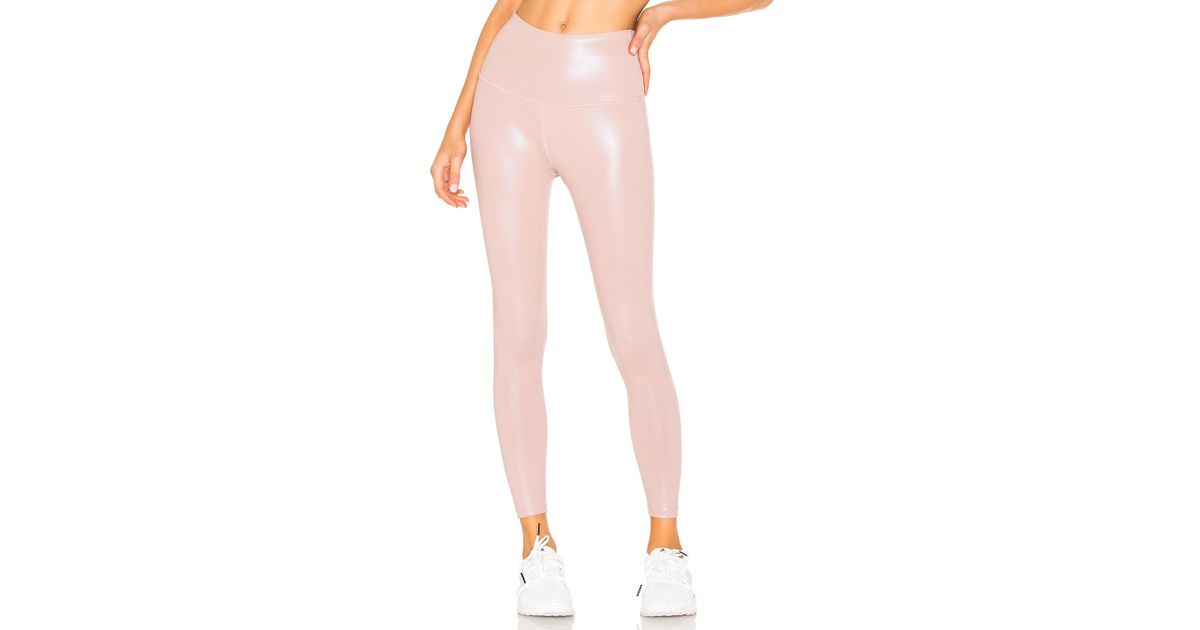 5847cb759e Beyond Yoga Pearlized High Waisted Midi Legging in Pink - Save 2% - Lyst
