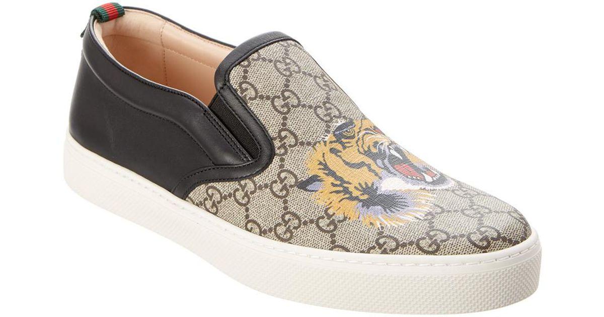 the latest 0742b 29c5a Gucci Black Gg Supreme Tiger Canvas & Leather Slip-on Sneaker