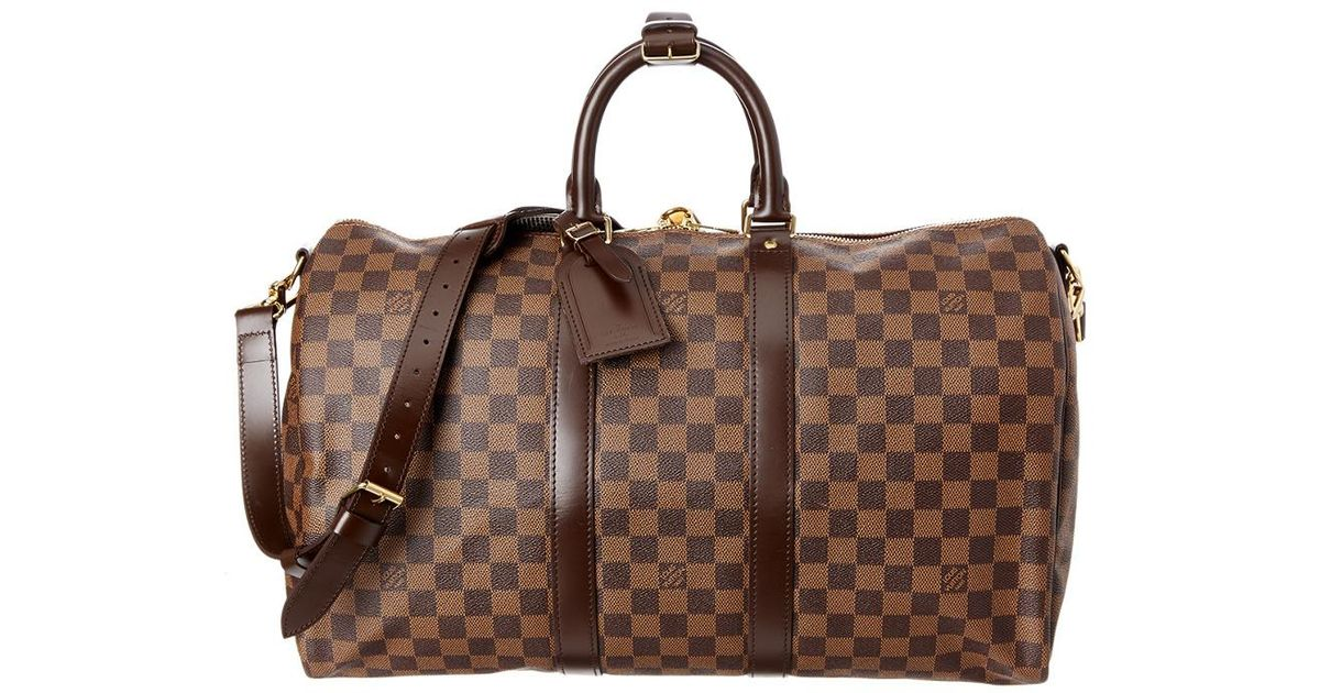 970413b44ddb Lyst - Louis Vuitton Damier Ebene Canvas Keepall 45 Bandouliere in Brown