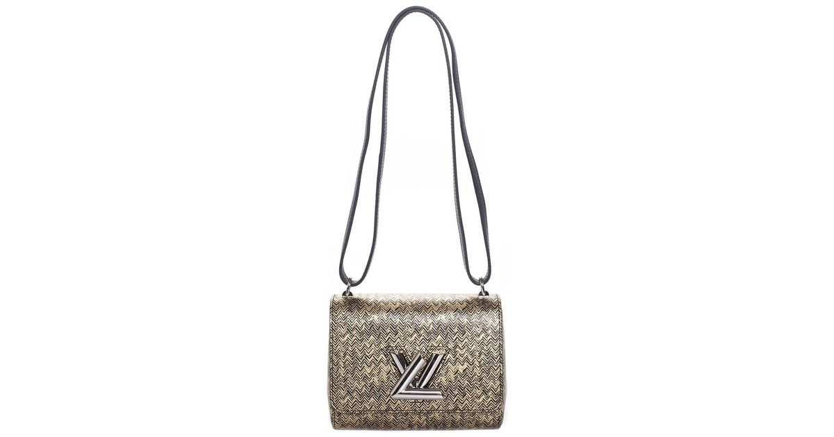b6a7e1b91d8c Louis Vuitton Gold & Black Leather Twist Pm in Metallic - Lyst