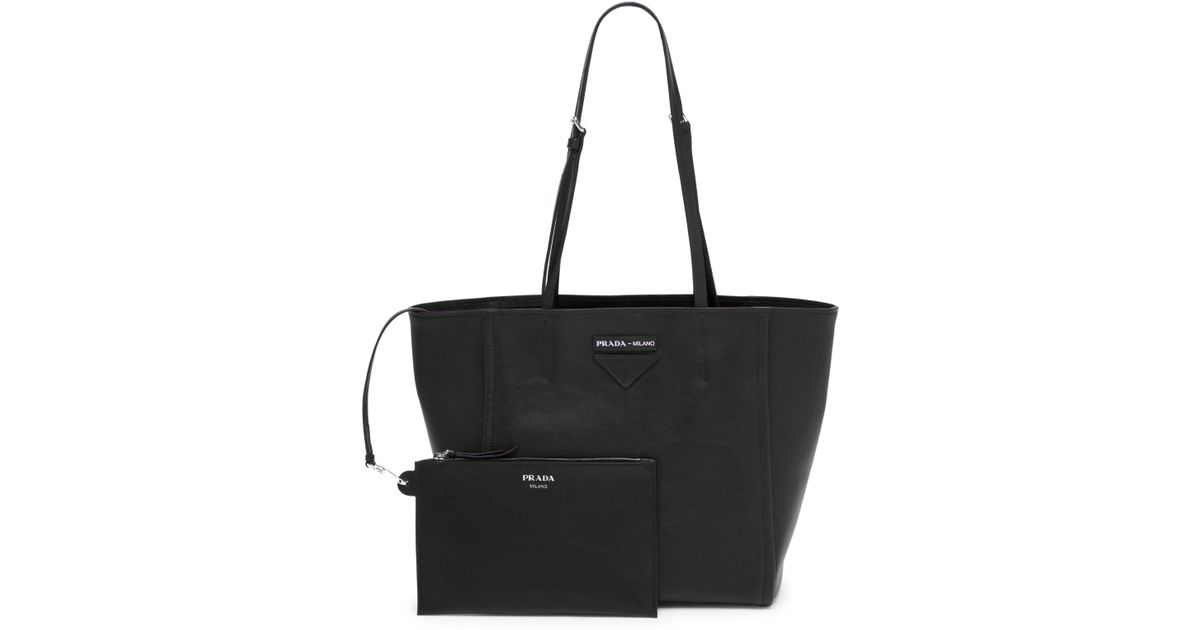 63c22fe168c4 ... shop lyst prada small grace luxe light tote in black 1c7a7 7450c