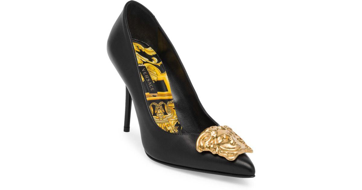 cf0b39bd4ba Lyst - Versace Gold Medusa Palazo Tribute Pumps in Black