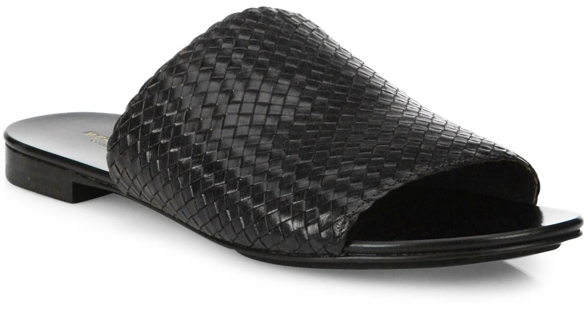 f886a6925c32 Lyst - Michael Kors Byrne Woven Leather Slides in Black