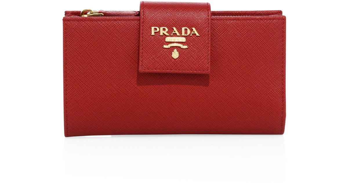 b607bbbdd283 ... spain prada saffiano leather tab wallet in red lyst 520c1 fa4f8