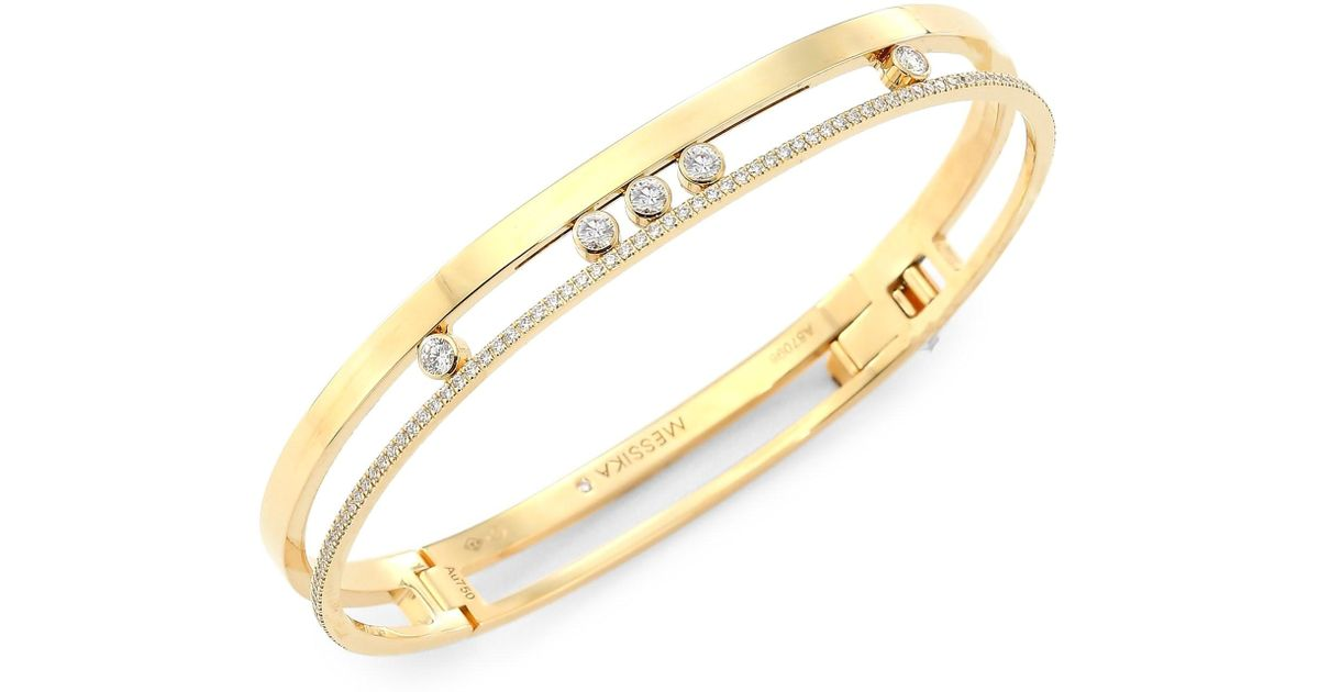 Diamond encrusted gold bracelet with 5 prominent diamonds in the center