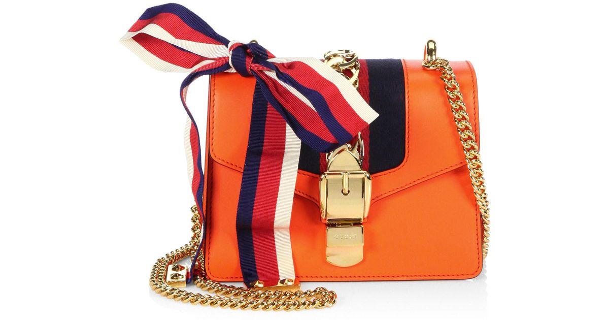 78b819b086b Lyst - Gucci Women s Sylvie Leather Mini Chain Bag - Red in Orange