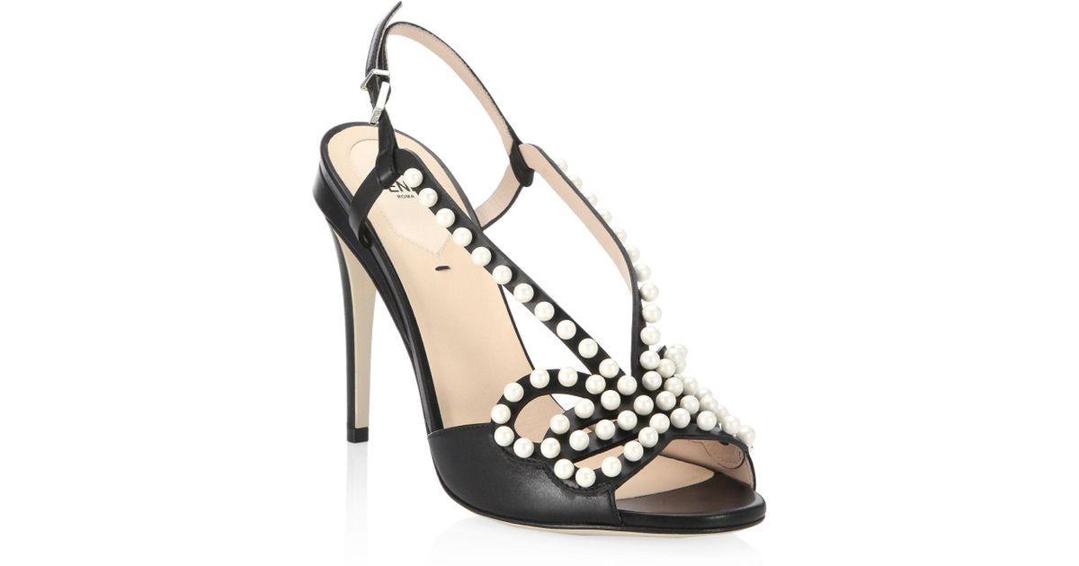 4205b6acc5d Lyst - Fendi Pearl Studded Bow Stiletto Sandals in Black