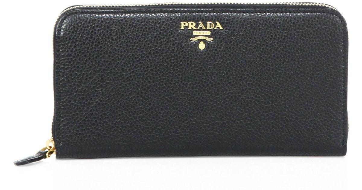cdd8f7628aa4a6 Lyst - Prada Women's Pebble Leather Two-tone Zip Wallet - Caramel Papaya in  Black