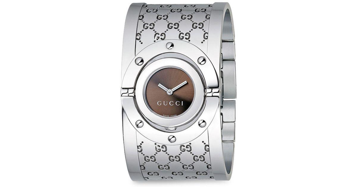6833275937d Lyst - Gucci Twirl Stainless Steel Monogram Bangle Bracelet Watch in  Metallic