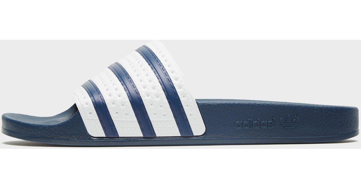 f95be6ca016afe Adidas Originals Adilette Slides in Blue for Men - Lyst