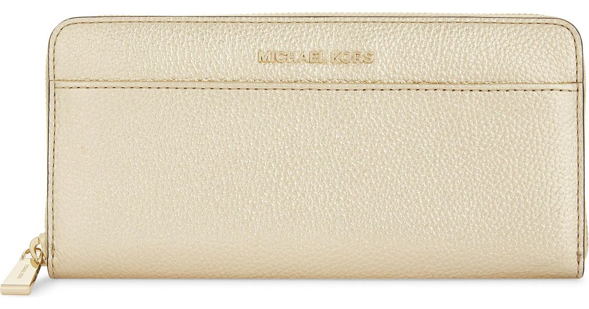 b40a775d18c0 ... Continental Metallic Leather Wallet In. Lyst Michael Kors Pale Gold  Mercer