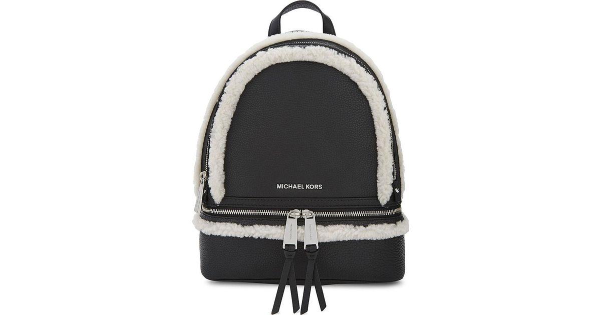 928b9e128174 Michael michael kors Rhea Shearling-Trimmed Leather Backpack in Black | Lyst