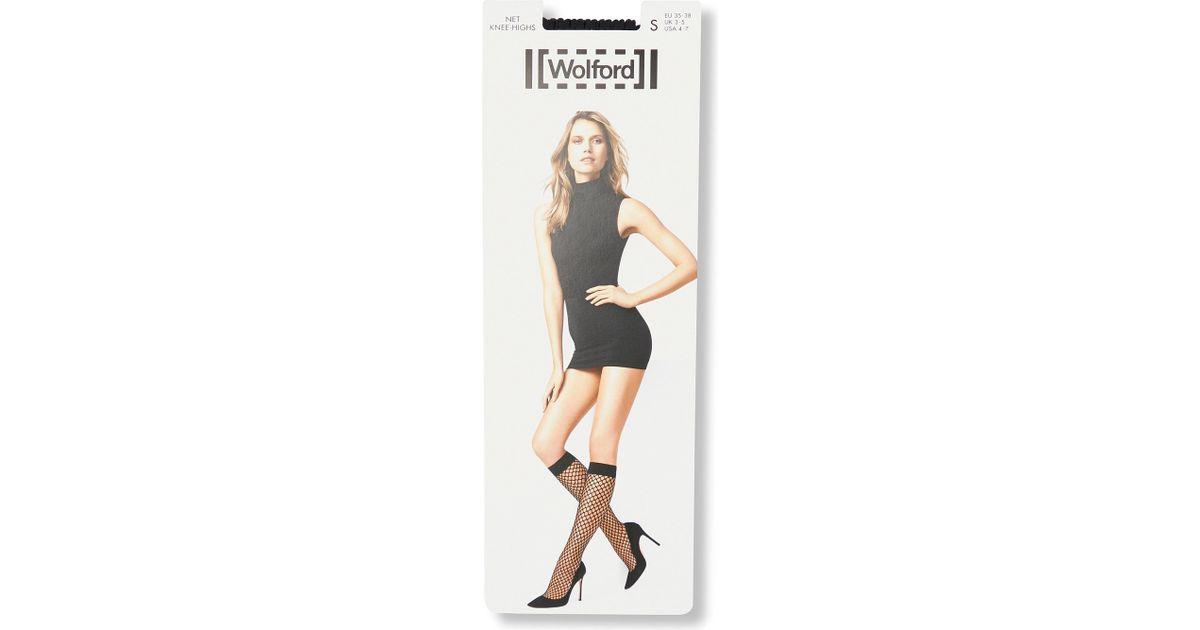 b19541de5 Lyst - Wolford Fishnet Knee-high Socks in Black