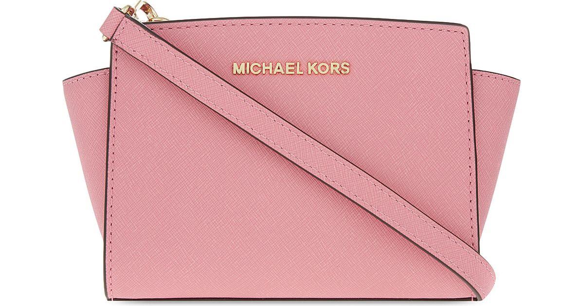 bba6e821974d Lyst - MICHAEL Michael Kors Selma Mini Saffiano Leather Messenger Bag in  Pink