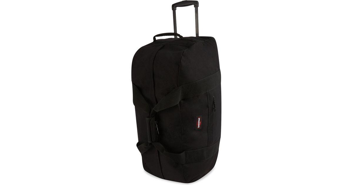 7c7c4814ebd Eastpak Container 2-wheeled Duffel Bag in Black for Men - Lyst