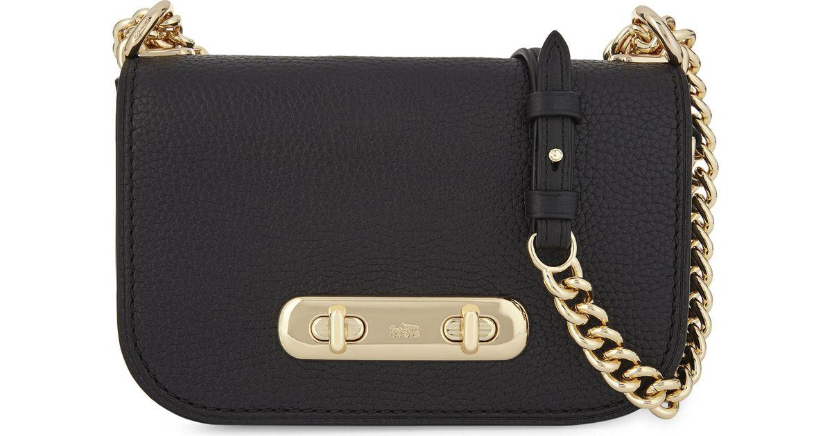 edf352df COACH Black Swagger 20 Pebbled Leather Cross-body Bag