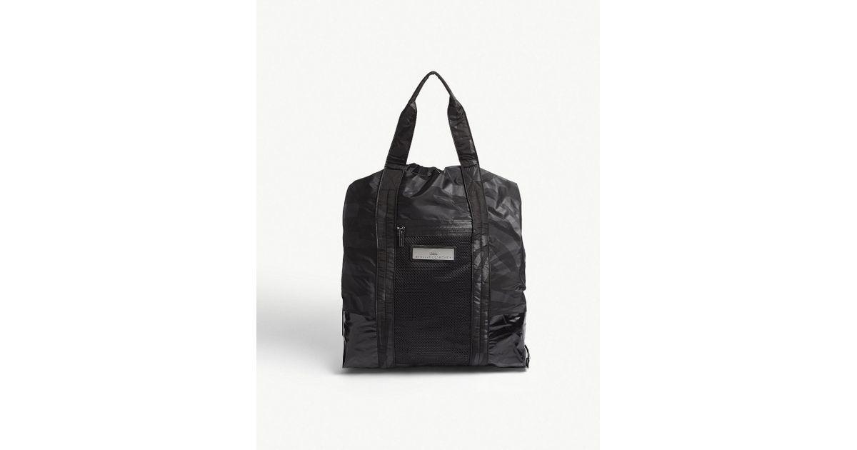 Lyst - adidas By Stella McCartney Zebra Striped Nylon Gym Bag in Black 9a1252c37a322