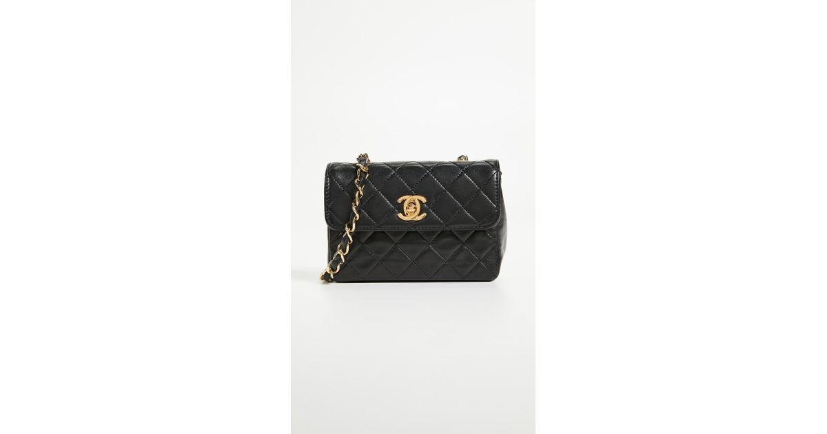 ef719148a743 What Goes Around Comes Around Chanel Lambskin Half Flap Micro Bag in Black  - Lyst