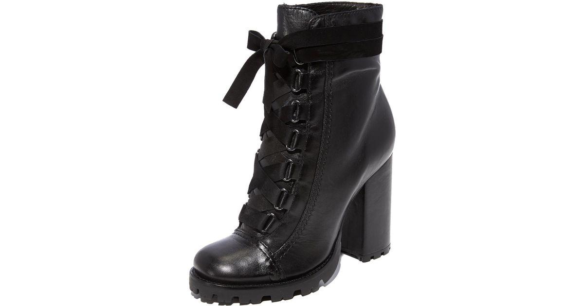 a895183e752b Lyst - Schutz Lisie Bow Platform Boots in Black