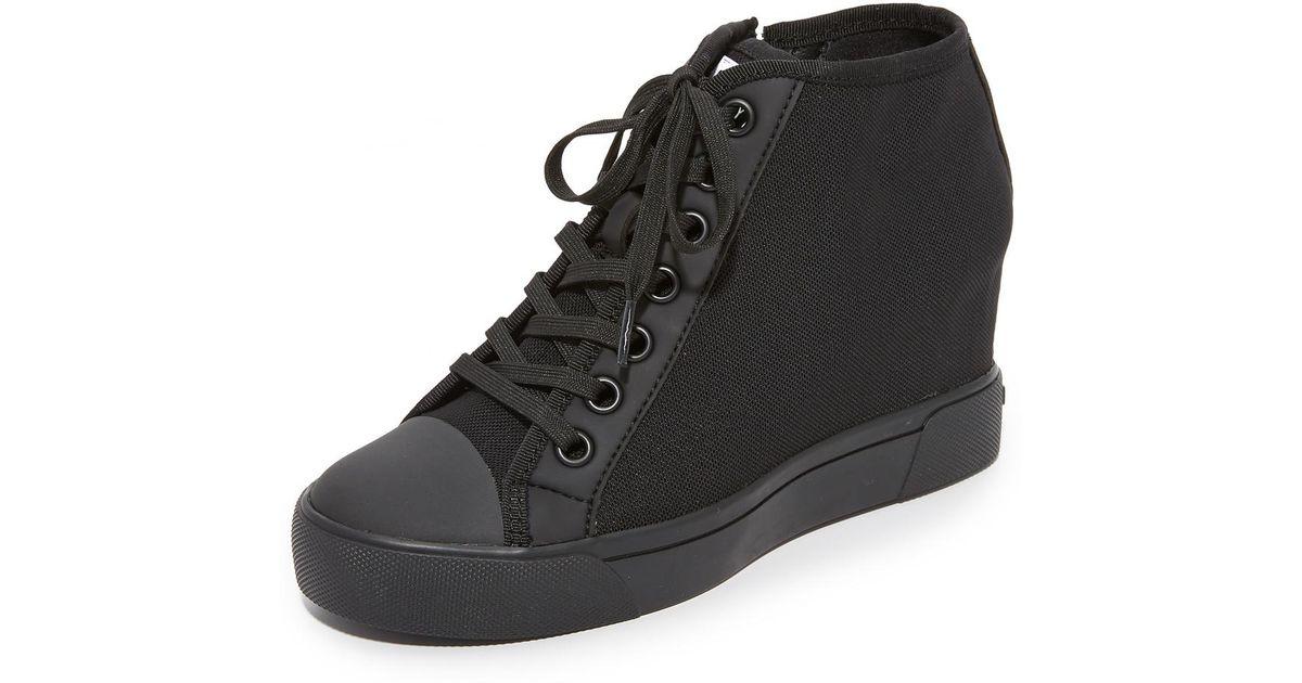 8f3c957319e3 DKNY - Black Cindy Mesh Wedge Sneakers - Lyst