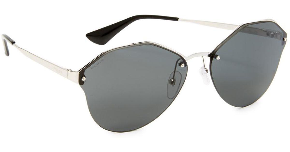 c093da9c82cb Prada Cinema Oval Sunglasses in Gray - Lyst