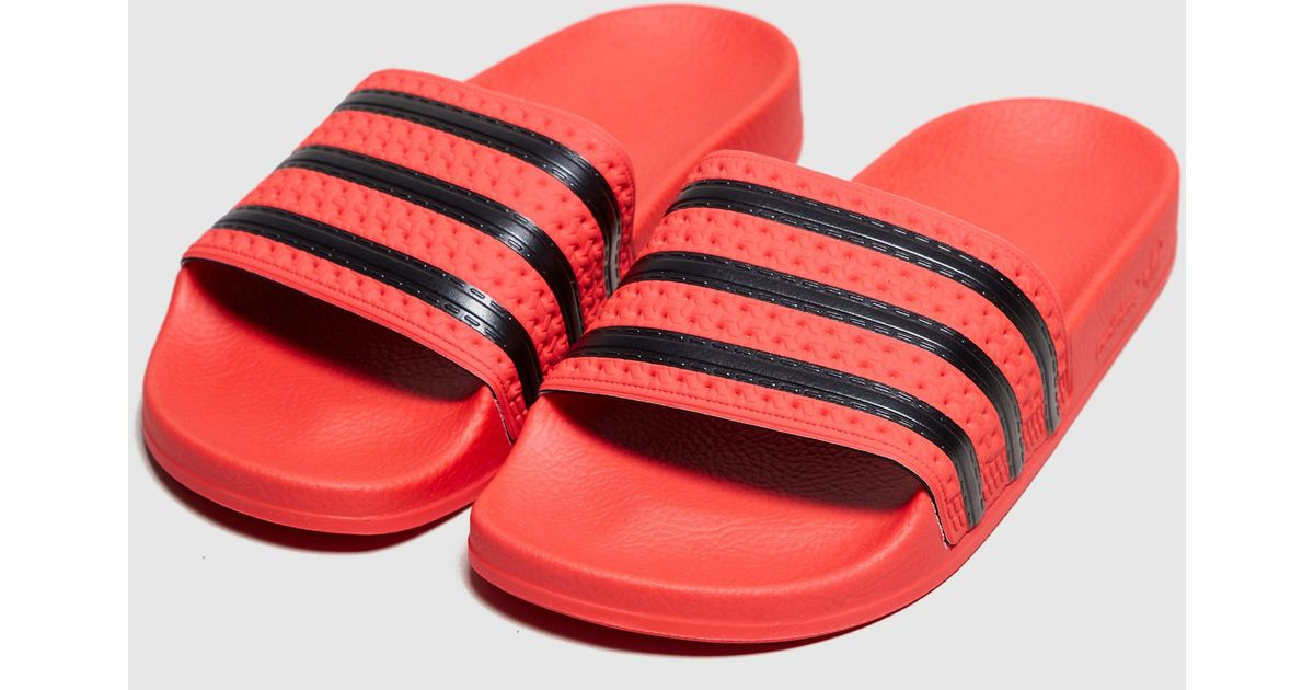 sports shoes e03fe 46aa9 adidas Originals Adilette Slides Women s in Red - Lyst