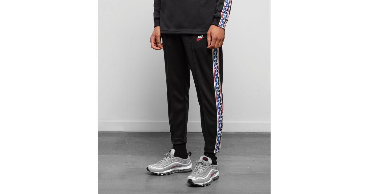 f5af9d58 Nike Taped Poly Track Pants in Black for Men - Lyst