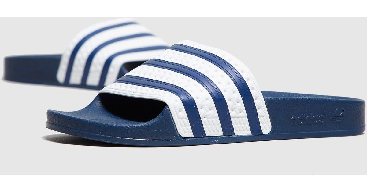 Lyst - adidas Originals Adilette Slides Women s in Blue for Men fa259935ba