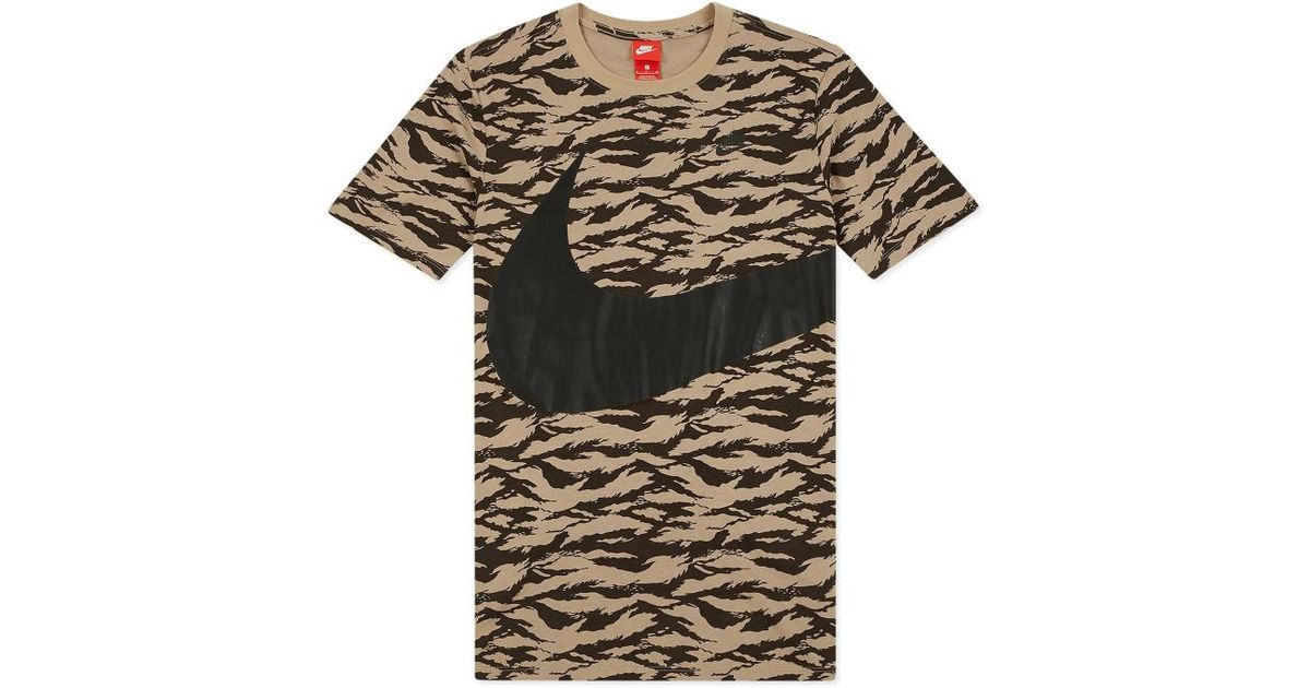 d928e5f5fd59 Lyst - Nike All Over Printed Swoosh T-shirt in Black for Men