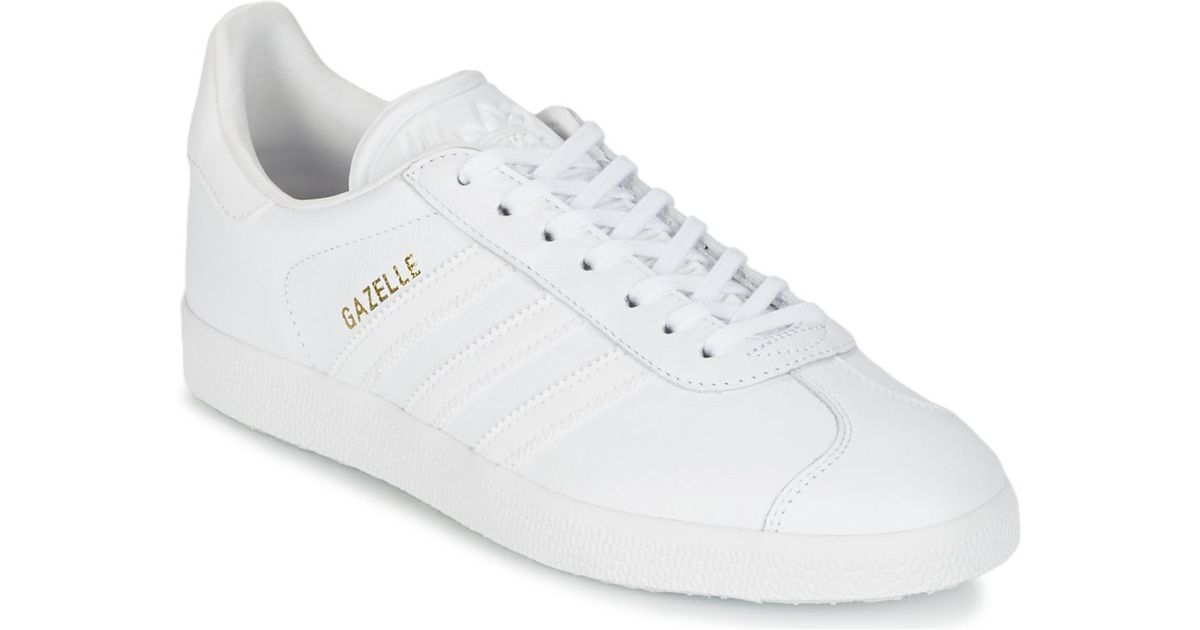 mens all white gazelles