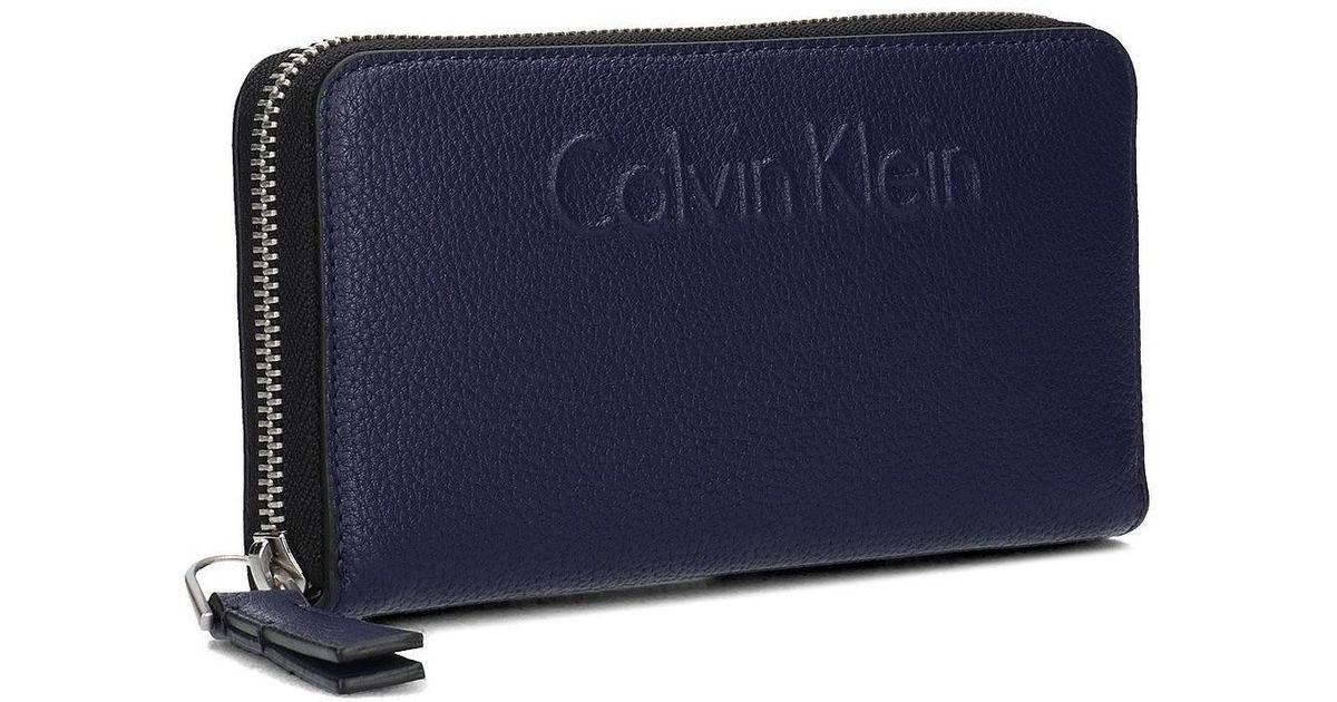 14a52b43a0 Calvin Klein Jeans Blue Edge Large Ziparound Men's Purse Wallet In  Multicolour for men