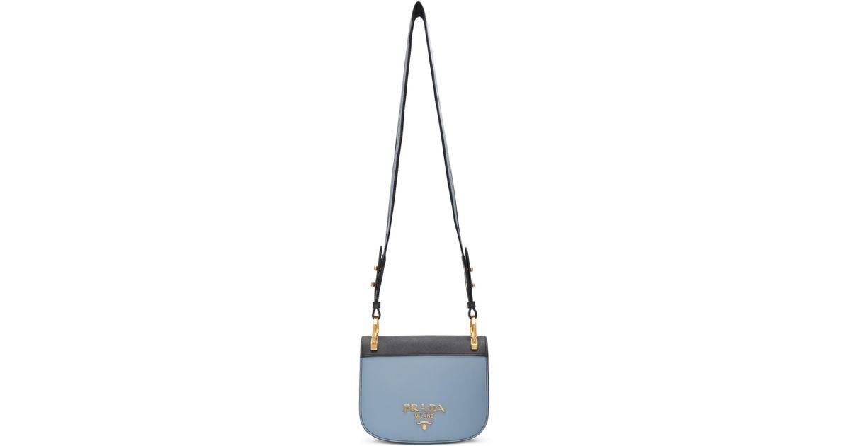 be2c74551f75 ... usa black saffiano tote info for 46a33 0f15d lyst prada blue pionniere  bag in blue 3fba3