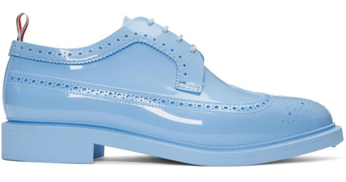 the latest f7301 bb867 thom-browne-blue-Blue-Rubber-Classic-Longwing-Brogues.jpeg