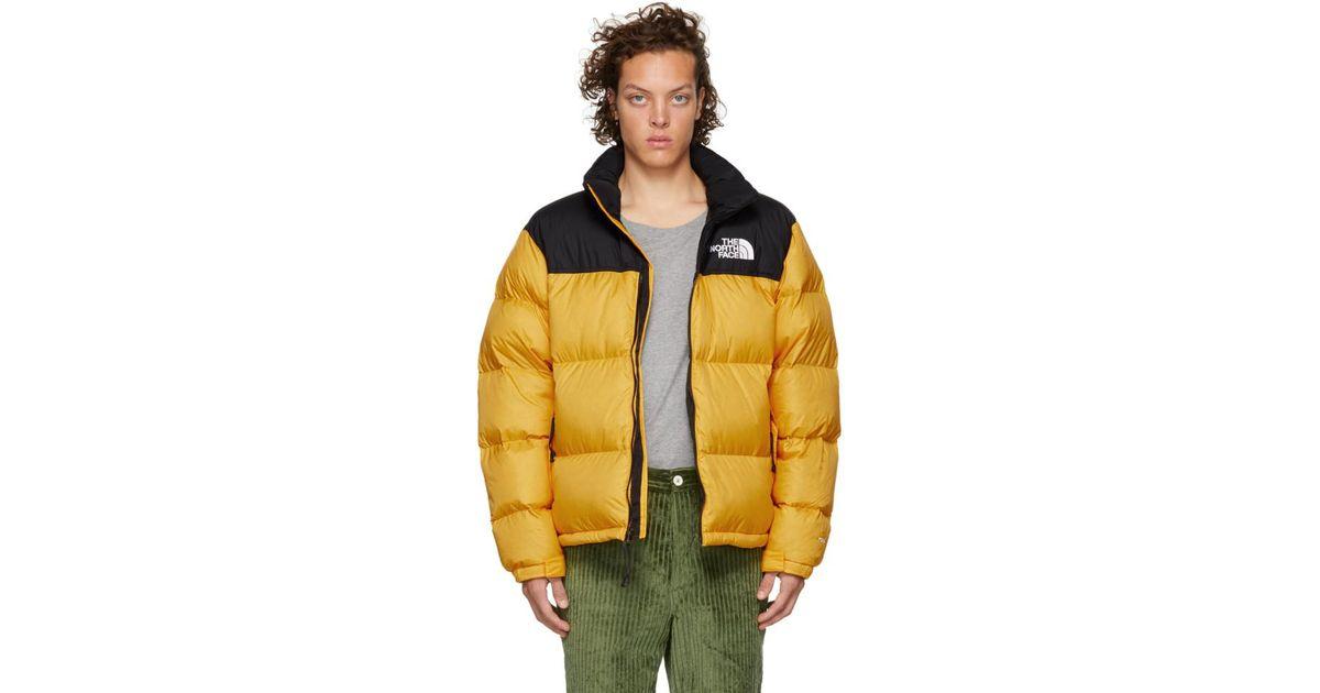 555e1d18f The North Face Yellow And Black 1996 Retro Nuptse Jacket for men