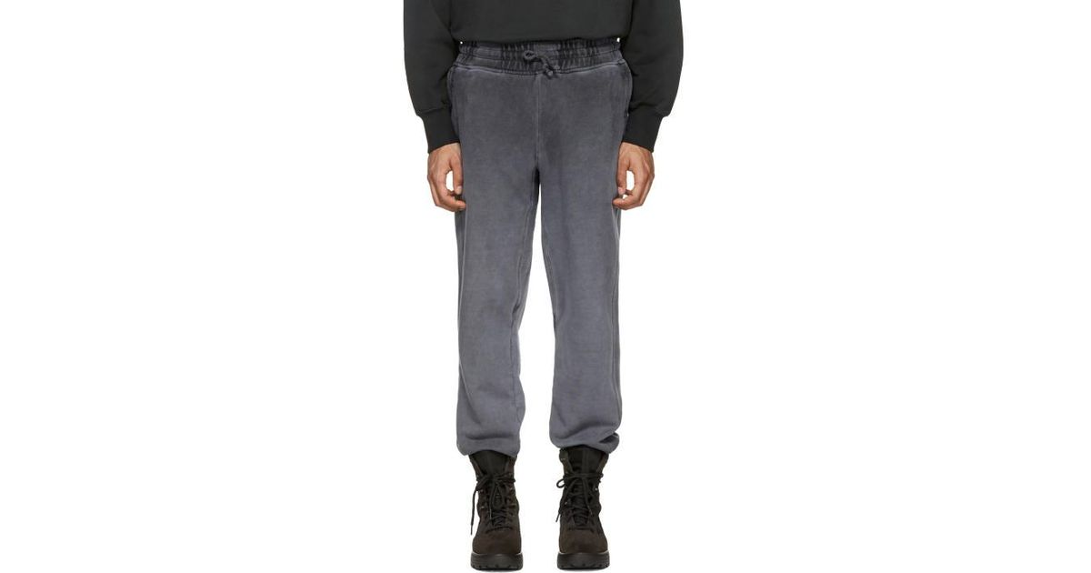 09d0ae44 Yeezy Black Panelled Sweatpants in Black for Men - Lyst