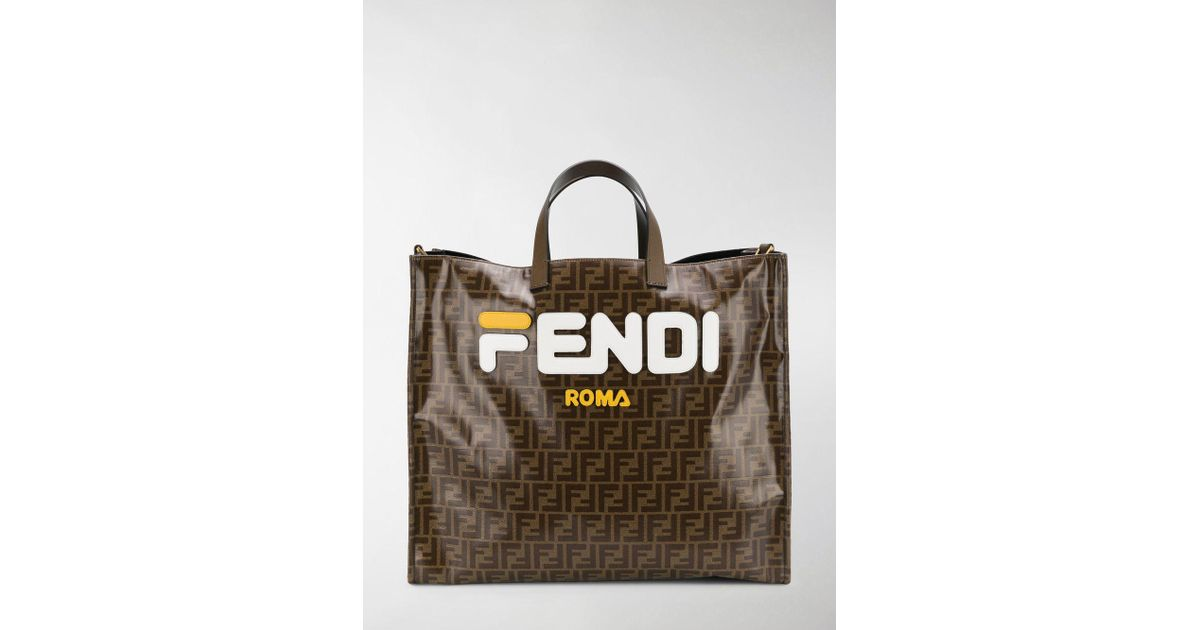 a91162f316a8 Lyst - Fendi Mania Brown And White Large Logo Print Tote Bag in Brown -  Save 25%
