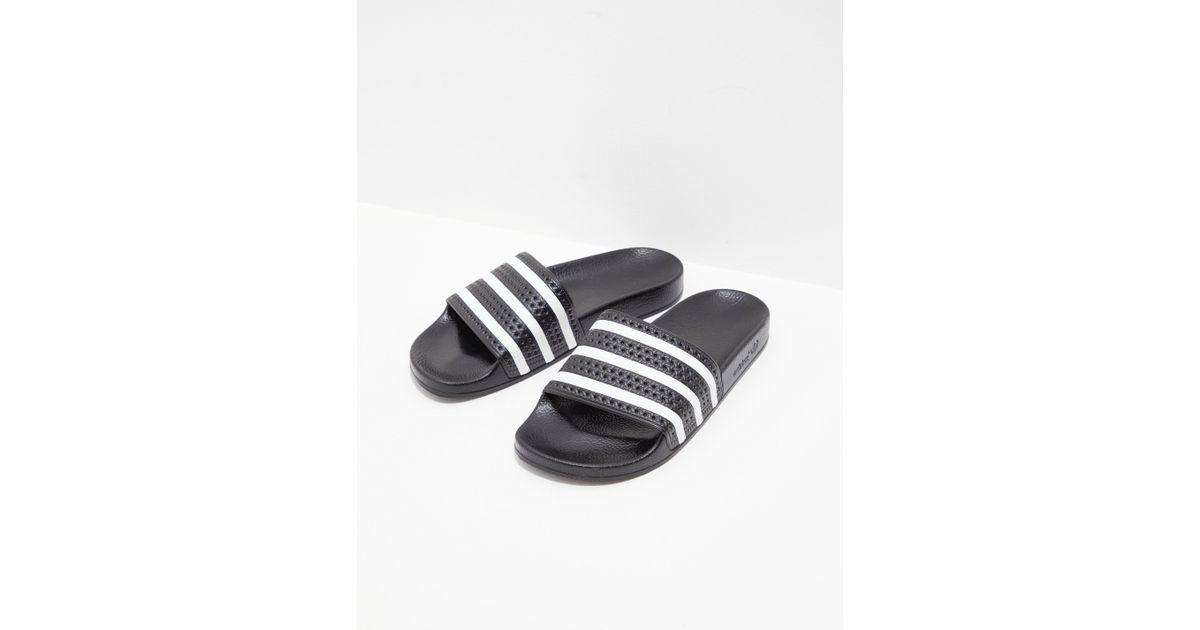 aa58648a7f10 Lyst - adidas Originals Mens Adilette Slides Black in Black for Men