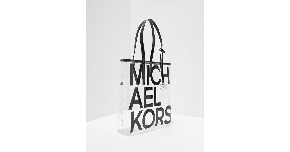 cab413176a64 ... discount michael kors the michael large graphic logo print clear tote  in black lyst 5d87c fa22f