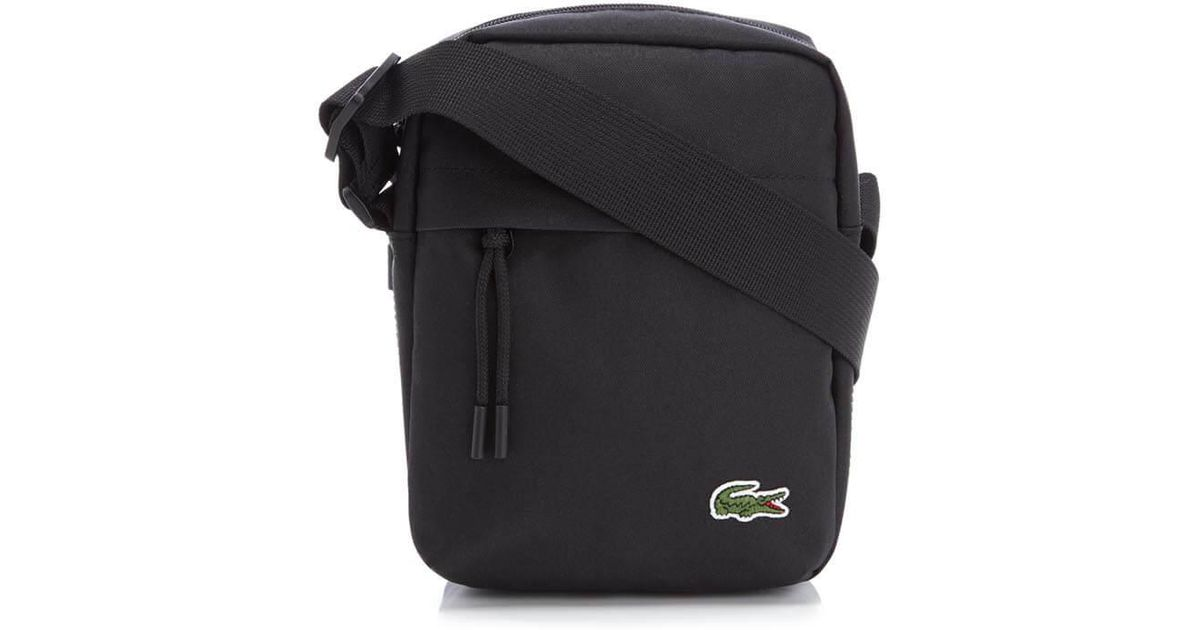 058475a666ddf Lacoste Vertical Camera Bag for Men - Lyst