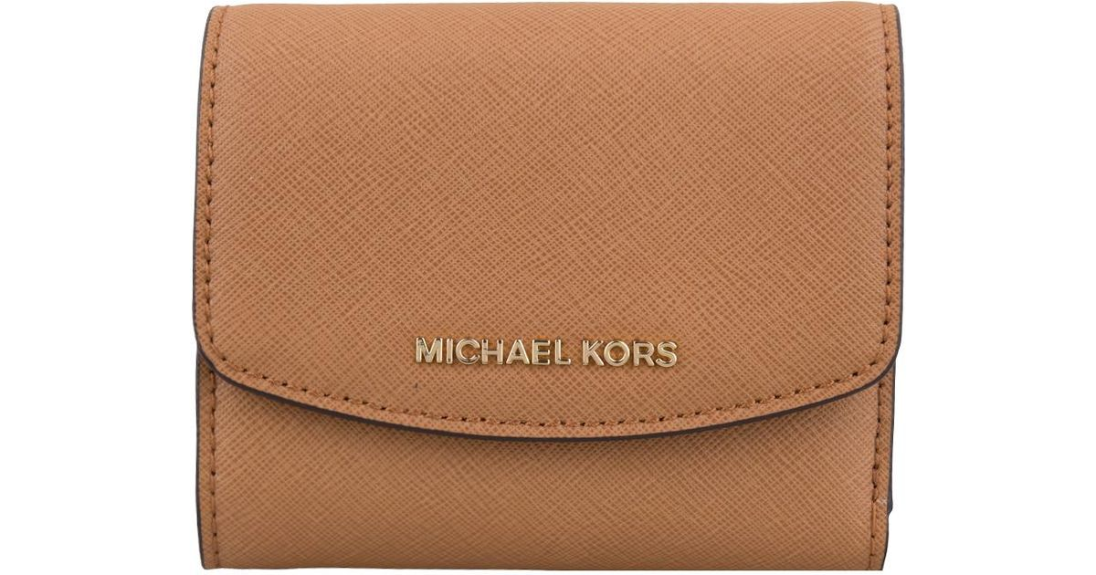 61e76f9c3564 Lyst - Michael Kors Trifold Wallet in Brown