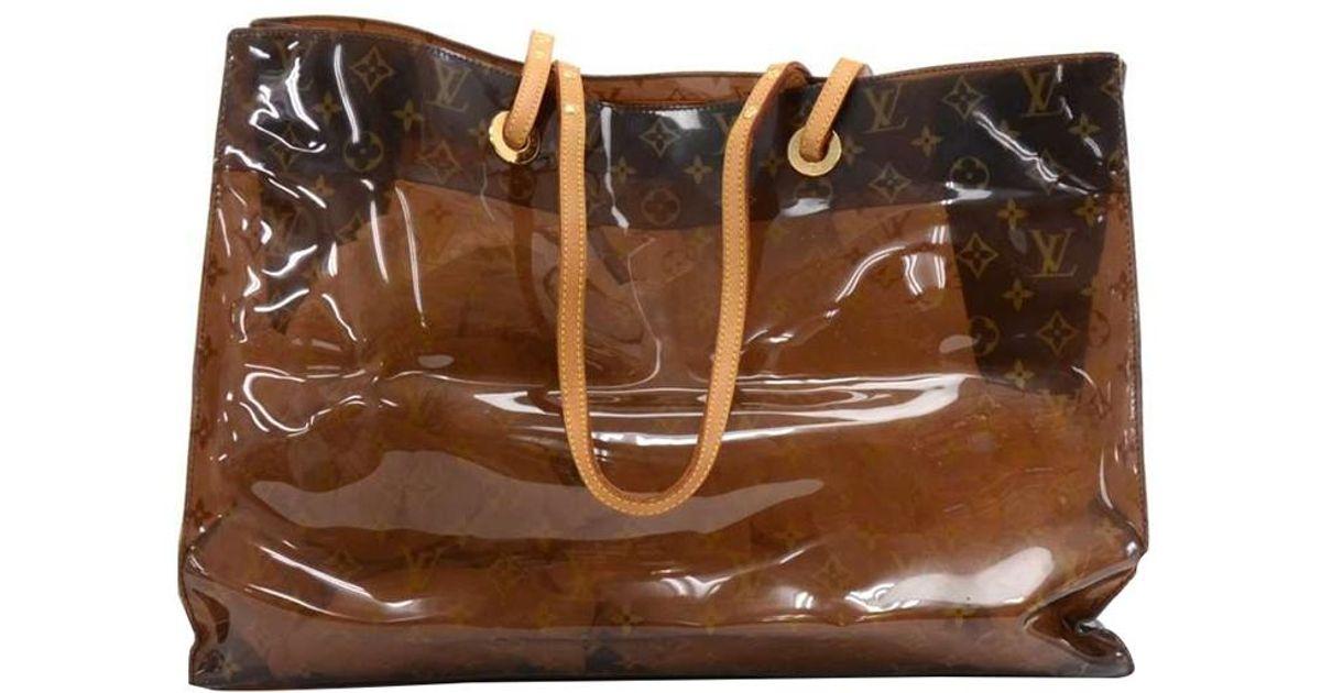 46b29264c2c Louis Vuitton Brown Monogram Vinyl Limited Edition Ambre Cruise Tote