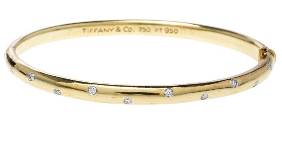 11119f2da Tiffany & Co. Etoile Diamond Platinum 18k Yellow Bangle Bracelet in  Metallic - Lyst