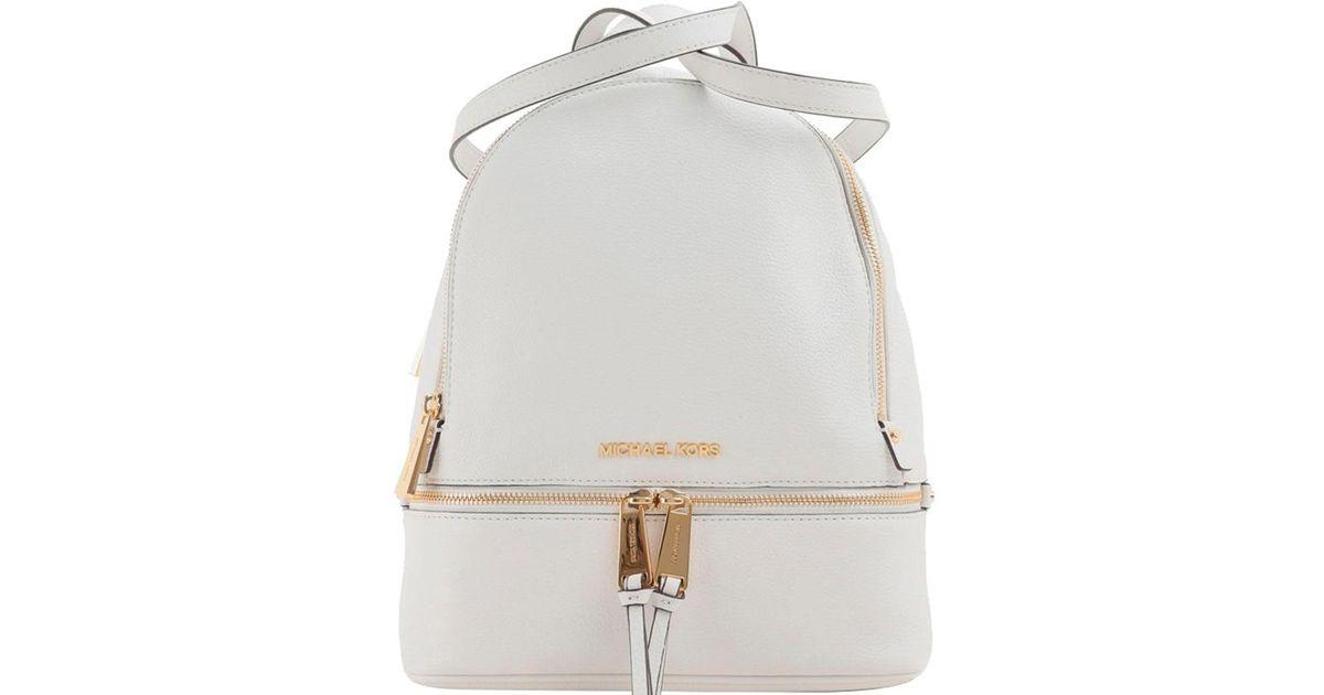 f9f4cb46d34e6 Lyst - Michael Kors Leather Medium Rhea Backpack in White