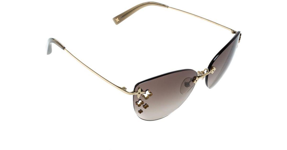 f968ad4c7f5f Lyst - Louis Vuitton Gradient Z0051u Desmayo Rimless Cat Eye Women  Sunglasses in Brown
