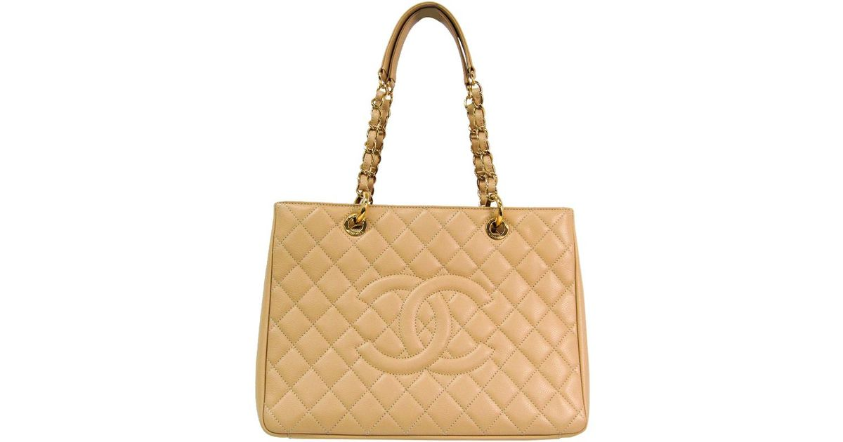 93f589aa887cb2 Lyst - Chanel Beige Quilted Caviar Grand Shopping Tote in Metallic