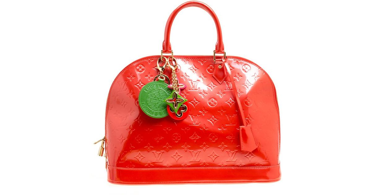d486d9f25149 Lyst - Louis Vuitton Orange Sunset Monogram Vernis Alma Gm Bag With Charm  in Red