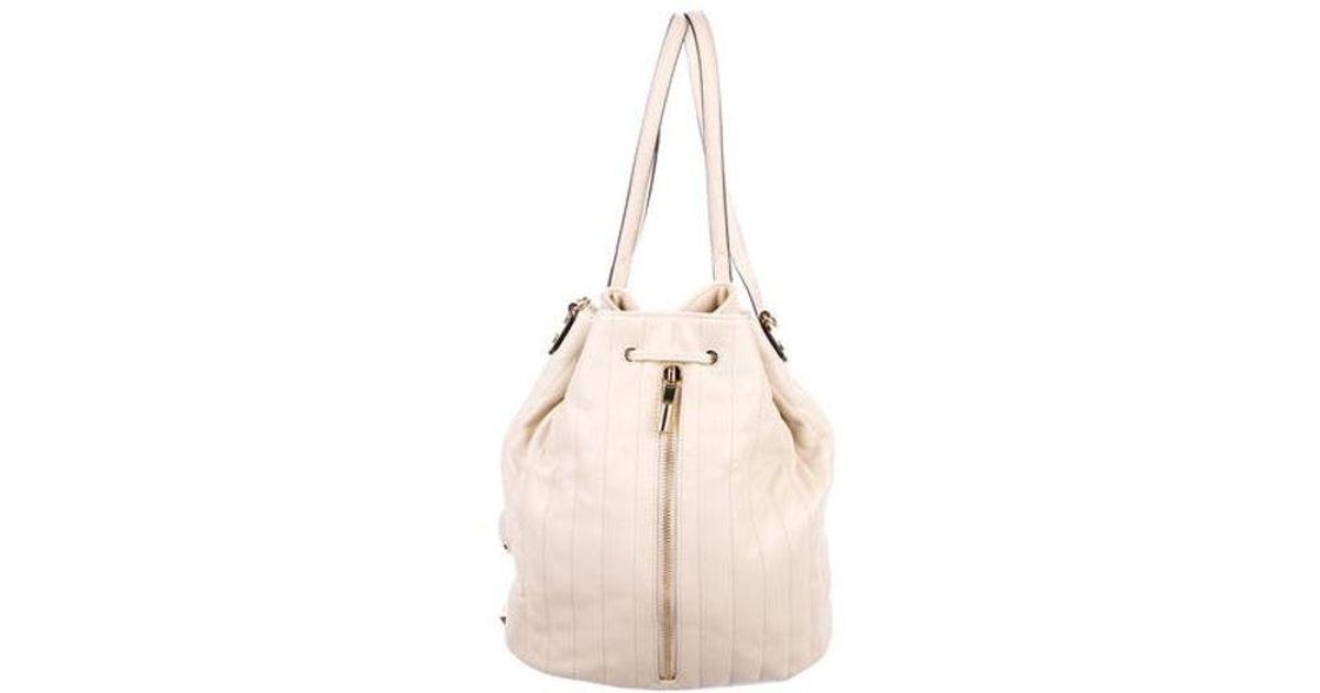 3ba82c7786 Lyst - Elizabeth And James Cynnie Grained Leather Bucket Bag W  Tags Gold  in Metallic