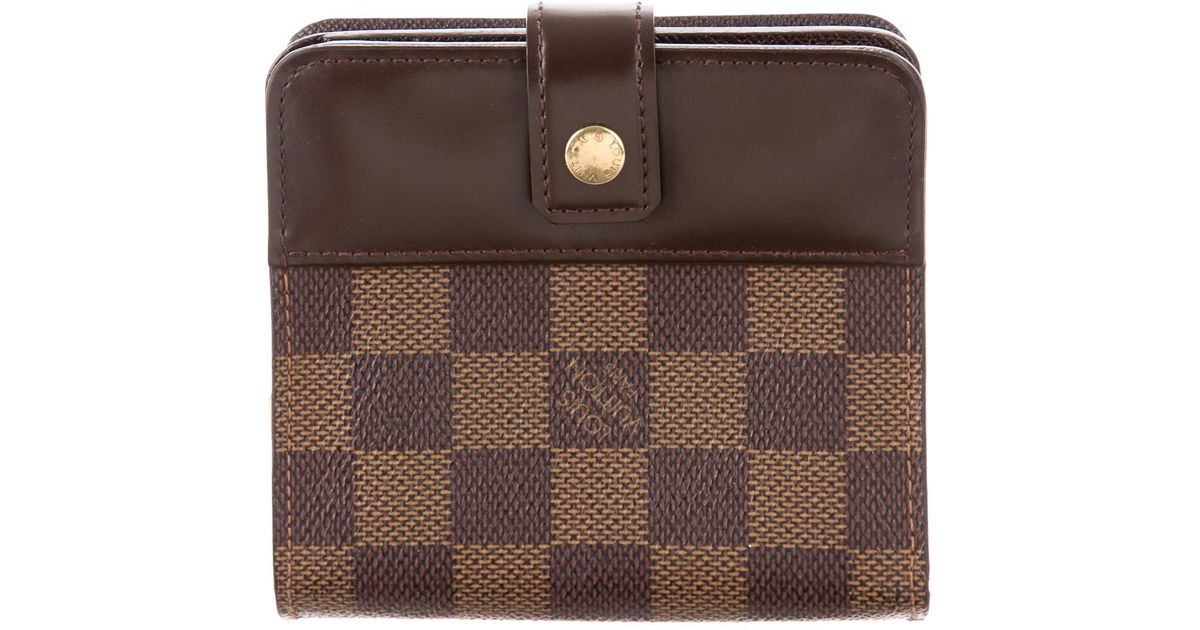 2fdb3103e789 Lyst - Louis Vuitton Damier Ebene Compact Zippé Wallet Tan in Natural