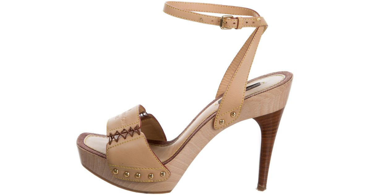 0abcaf23ab Lyst - Louis Vuitton Studded Platform Sandals Tan in Natural