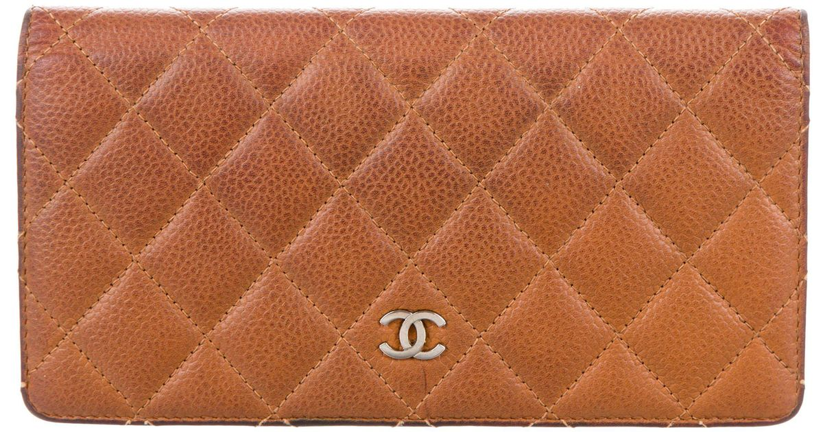 b2cc573c9c64 Lyst - Chanel Caviar Quilted Yen Wallet Brown in Metallic